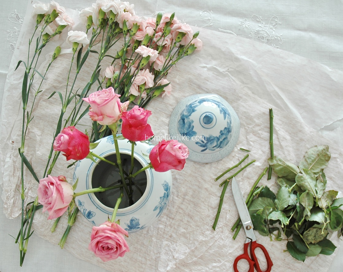 pink flowers and blue and white ceramic - homelikeilike.com